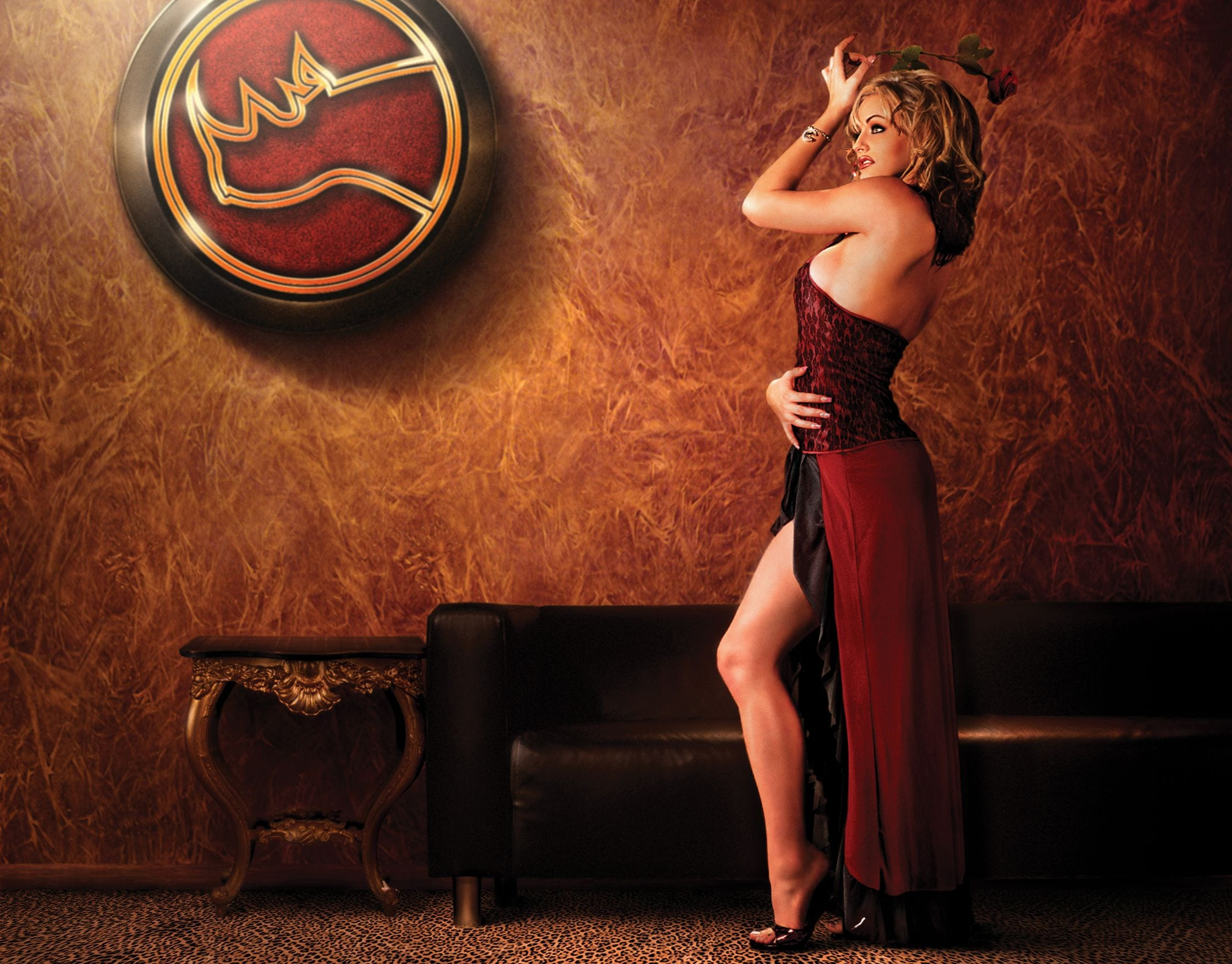 cover girl posing in front of spearmint rhino logo